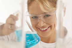 Scientist holding beaker Royalty Free Stock Photos