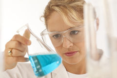 Scientist holding beaker Royalty Free Stock Photo