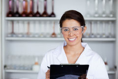Scientist holding a clipboard Royalty Free Stock Image