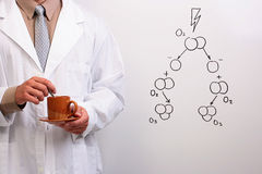 Scientist holding a cup of coffee Stock Images