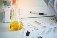 Scientist holding documents folder with analysis results. Test water in tube stock photos