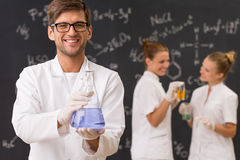 Scientist holding a laboratory glassware Royalty Free Stock Photos