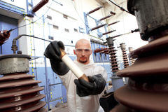 Scientist holding large fuse Royalty Free Stock Image