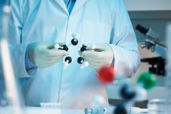 Scientist holding molecular model stock photos