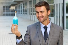 Scientist holding a secret elixir.  stock photography