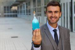 Scientist holding a secret elixir.  royalty free stock images