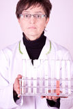 Scientist holding test tubes Royalty Free Stock Images