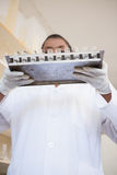 Scientist holding tray with test tubes Stock Images