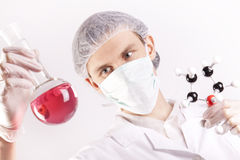 Scientist Holding Tube and Atoms Royalty Free Stock Images