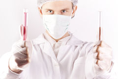 Scientist Holding Tubes. Scientist Experimenting witch red fluids in laboratory Stock Images