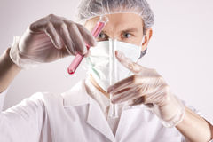 Scientist Holding Tubes Royalty Free Stock Image
