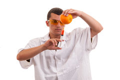 Scientist injecting GMO into orange Stock Images