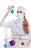 Scientist in lab with chemical glassware Royalty Free Stock Images