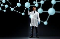 Scientist in lab coat with molecules Stock Images