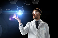 Scientist in lab goggles chemical formula Stock Photo