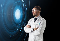 Scientist in lab goggles with virtual projection. Science, future technology and people concept - male doctor or scientist in white lab coat and safety glasses Royalty Free Stock Photo