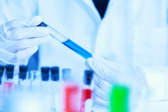 Scientist with laboratory background and concept. Stock Image