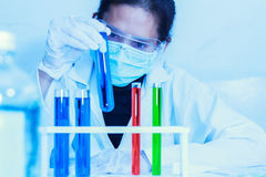 Scientist with laboratory background and concept. Royalty Free Stock Photo