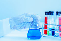 Scientist with laboratory background and concept. Stock Images