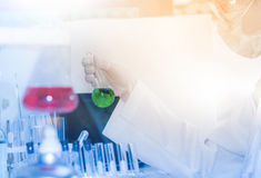 Scientist with laboratory and lighting background and concept. Stock Photos