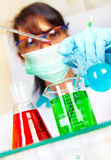 Scientist in laboratory with test tubes Royalty Free Stock Photography
