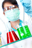 Scientist in laboratory with test tubes Royalty Free Stock Photos
