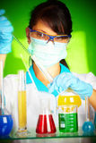 Scientist in laboratory with test tubes Stock Images