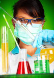 Scientist in laboratory with test tubes Stock Image