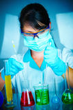 Scientist in laboratory with test tubes Stock Photos
