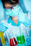 Scientist in laboratory with test tubes Royalty Free Stock Images