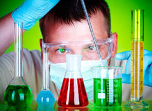 Scientist in laboratory with test tubes Stock Photography