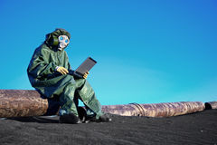Scientist with a laptop on contaminated area Royalty Free Stock Photography