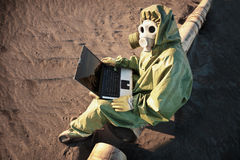 Scientist with laptop in zone of disaster Stock Photography