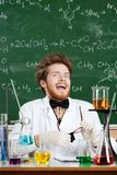 Scientist laughs madly. In his laboratory Royalty Free Stock Photography