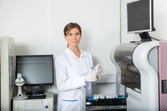 Scientist Loading Coagulation Analyzer With Royalty Free Stock Photography