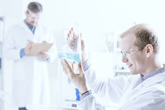 Scientist looking at chemical material stock photos