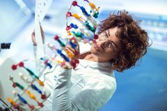 Scientist looking at DNA. In laboratory stock photo