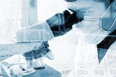 Scientist looking through a microscope for chemistry test sample. S, examining. Laboratory research concept Royalty Free Stock Photography