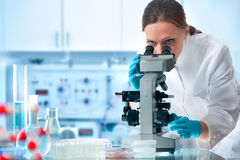 Scientist looking through a microscope Royalty Free Stock Image