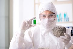 The scientist looking and stone samples in lab. Scientist looking and stone samples in lab Royalty Free Stock Photo