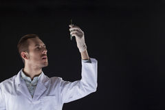 A scientist looking at test tube Royalty Free Stock Image
