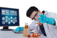 Scientist makes chemical reactions Royalty Free Stock Image