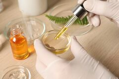 Free Scientist Making Cosmetic Product At Wooden Table, Closeup Stock Photography - 216585632