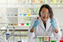Scientist man checking test tubes stock images