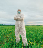 Scientist man standing on summer field Stock Photo