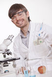 Scientist manipulating doping substances. Corrupted scientist with syringe manipulating doping substances Stock Photos