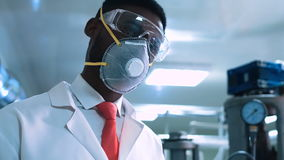 Scientist in mask writing in lab stock video