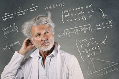 Scientist with mathematics formulas Stock Photo
