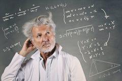 Scientist with mathematics formulas Stock Photo