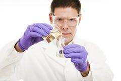 Scientist Measuring Liquid Stock Image